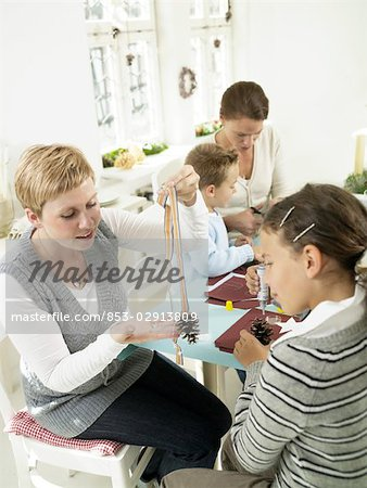 Children and women doing crafts Stock Photo - Rights-Managed, Image code: 853-02913809