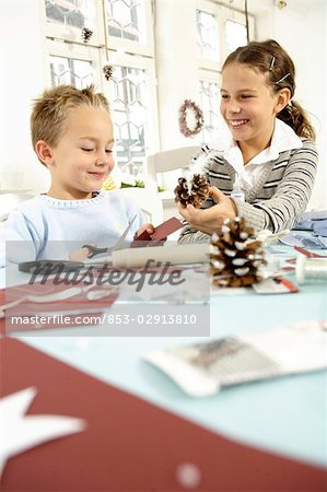 Two children doing crafts Stock Photo - Rights-Managed, Image code: 853-02913810