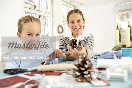 Two children doing crafts Stock Photo - Rights-Managed, Image code: 853-02913811