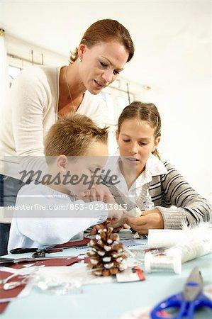 Children doing crafts Stock Photo - Rights-Managed, Image code: 853-02913813