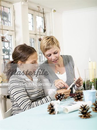 Mother and daughter doing crafts Stock Photo - Rights-Managed, Image code: 853-02913819