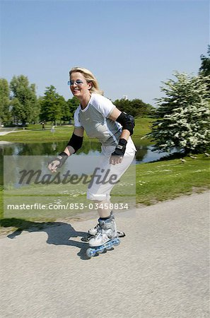 Senior woman inline skating, high size Stock Photo - Rights-Managed, Image code: 853-03458834