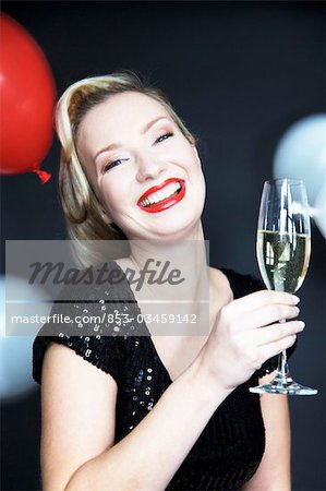 Woman holding champagne glass Stock Photo - Rights-Managed, Image code: 853-03459142