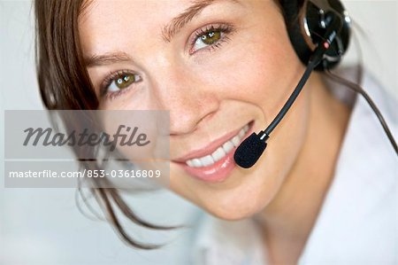 Smiling woman wearing headset, portrait Stock Photo - Rights-Managed, Image code: 853-03616809