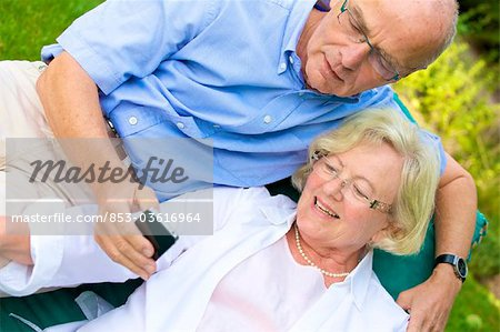 Happy senior couple with smartphone in garden Stock Photo - Rights-Managed, Image code: 853-03616964