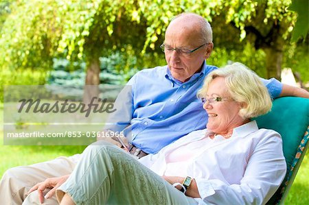 Happy senior couple with smartphone in garden Stock Photo - Rights-Managed, Image code: 853-03616965