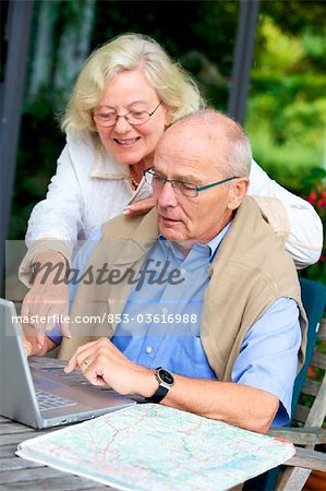 Senior couple on terrace with laptop and road map Stock Photo - Rights-Managed, Image code: 853-03616988