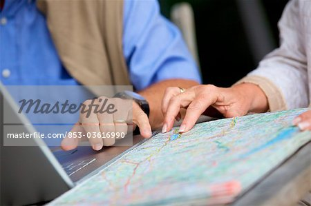 Senior couple with laptop and road map, close-up Stock Photo - Rights-Managed, Image code: 853-03616990