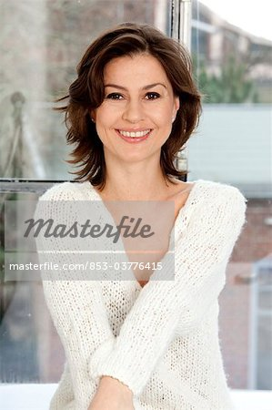 Smiling brunette woman, portrait Stock Photo - Rights-Managed, Image code: 853-03776415
