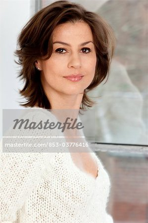 Confident brunette woman, portrait Stock Photo - Rights-Managed, Image code: 853-03776416