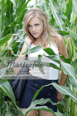 Young woman in cornfield Stock Photo - Rights-Managed, Image code: 853-05523698