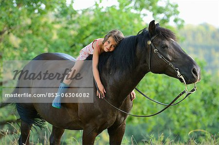 Girl lying on horse Stock Photo - Rights-Managed, Image code: 853-06306082