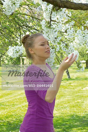 Young woman sneezing Stock Photo - Rights-Managed, Image code: 853-06441401