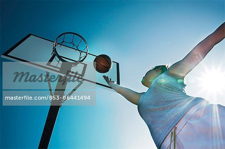 Young woman playing basketball Stock Photo - Rights-Managed, Image code: 853-06441494
