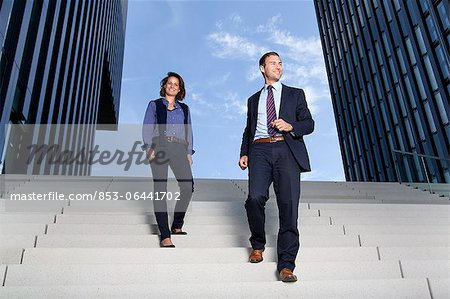 Businessman and businesswoman walking on stairs Stock Photo - Rights-Managed, Image code: 853-06441702