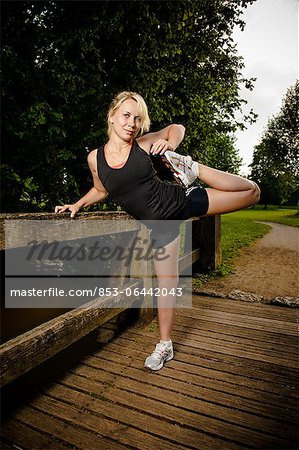 Young woman doing fitness training Stock Photo - Rights-Managed, Image code: 853-06442043
