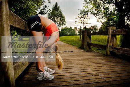 Young woman doing fitness training Stock Photo - Rights-Managed, Image code: 853-06442050