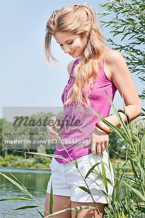 Blond young woman at a lake Stock Photo - Rights-Managed, Image code: 853-06442055