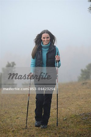 Brunette young woman Nordic walking Stock Photo - Rights-Managed, Image code: 853-06623256