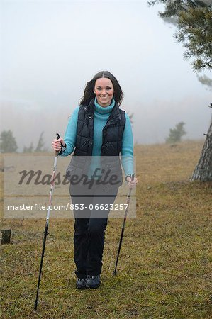 Brunette young woman Nordic walking Stock Photo - Rights-Managed, Image code: 853-06623257