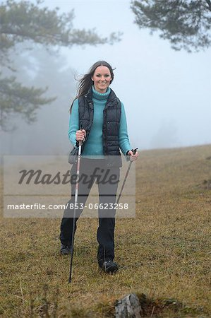 Brunette young woman Nordic walking Stock Photo - Rights-Managed, Image code: 853-06623258