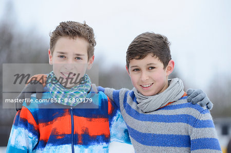 Two boys embracing outdoors, portrait Stock Photo - Rights-Managed, Image code: 853-06893179