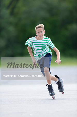 Boy with in-line skates on a sports place Stock Photo - Rights-Managed, Image code: 853-07148590