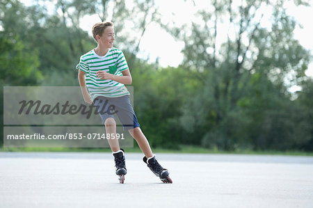 Boy with in-line skates on a sports place Stock Photo - Rights-Managed, Image code: 853-07148591