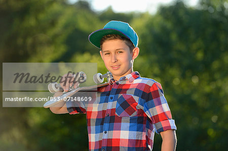 Boy with skateboard, portrait Stock Photo - Rights-Managed, Image code: 853-07148609