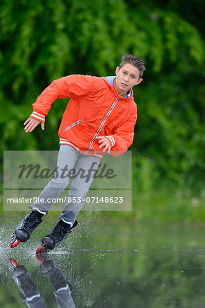 Boy with in-line skates on a rainy day Stock Photo - Rights-Managed, Image code: 853-07148623
