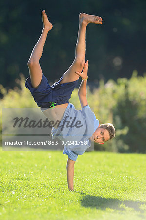 Teenager doing a handstand, Upper Palatinate, Bavaria, Germany, Europe Stock Photo - Rights-Managed, Image code: 853-07241758