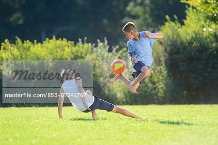 Two teenage boys playing football on a meadow, Upper Palatinate, Bavaria, Germany, Europe Stock Photo - Rights-Managed, Image code: 853-07241767