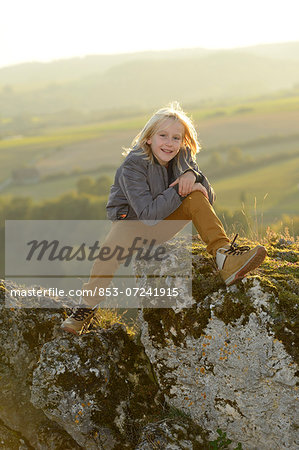 Boy sitting on a rock Stock Photo - Rights-Managed, Image code: 853-07241915