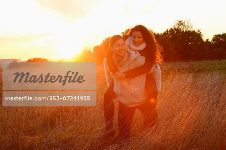 Smiling couple in field in autumn Stock Photo - Rights-Managed, Image code: 853-07241955