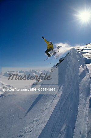 Snowboarder in Mid-Air on Mt.Ogden Juneau Southeast AK winter scenic Stock Photo - Rights-Managed, Image code: 854-02954864