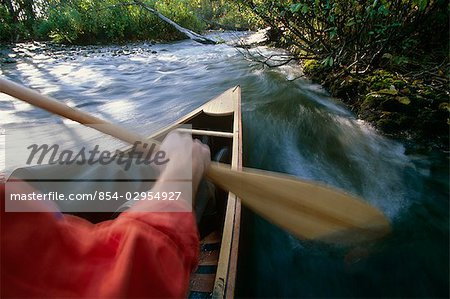 Person canoeing in Campbell Creek SC Alaska summer Stock Photo - Rights-Managed, Image code: 854-02954927