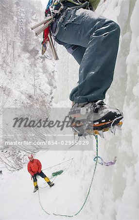 Two ice climbers climbing frozen waterfall in Hunter Creek Canyon, Chugach Mountains, Alaska Stock Photo - Rights-Managed, Image code: 854-02955029