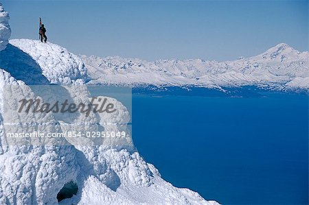 Mountaineer Standing on ridge viewing vast scenery from Augustine Volcano across Cook Inlet Alaska Stock Photo - Rights-Managed, Image code: 854-02955049