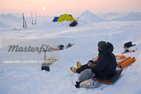 Climber enjoys a winter sunset in the Chugach Mountains above Prince William Sound, Alaska Stock Photo - Rights-Managed, Image code: 854-02955072