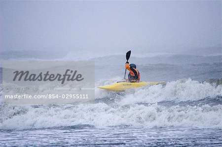 Man kayak surfing in winter storm surf Kachemak Bay near Homer Kenai Peninsula Alaska Winter Stock Photo - Rights-Managed, Image code: 854-02955111