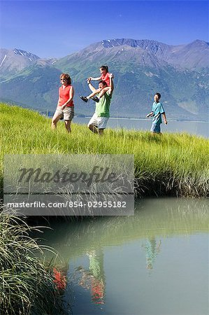 Family hiking in meadow near Bird Point along Turnagain Arm, with Kenai Mtns background, AK Summer Stock Photo - Rights-Managed, Image code: 854-02955182