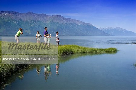 Family hiking in meadow near Bird Point along Turnagain Arm, with Kenai Mtns background, AK Summer Stock Photo - Rights-Managed, Image code: 854-02955183