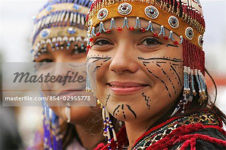 with traditional Alutiiq headdresses and facial tattoos at the Alaska