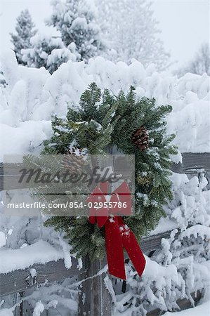 Holiday christmas wreath hanging on snow covered split rail fence Anchorage Alaska Southcentral Winter Stock Photo - Rights-Managed, Image code: 854-02955786