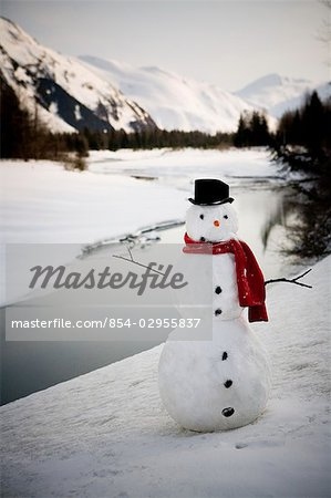 Lighted snowman decoration standing on riverbank Alaska Winter Stock Photo - Rights-Managed, Image code: 854-02955837