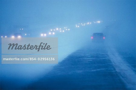 Cars on highway / snowstorm/nview through windshield  AK Stock Photo - Rights-Managed, Image code: 854-02956136