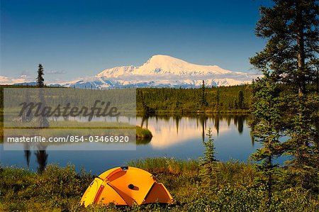 Tent camping in Wrangell Saint Elias National Park with Mount Sanford in the background, Southcentral Alaska, Summer Stock Photo - Rights-Managed, Image code: 854-03466920