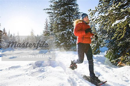 Young woman on snowshoes enjoy the outdoors near Homer, Alaska during winter. Stock Photo - Rights-Managed, Image code: 854-03537972