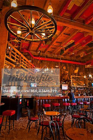 Tourist sits at the bar of the Red Dog Saloon in Juneau, Southeast Alaska, Summer Stock Photo - Rights-Managed, Image code: 854-03646299
