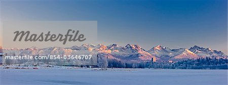 Panoramic view of the sunset casting a pink glow over the Chugach Mountains, Anchorage, Southcentral Alaska, Winter Stock Photo - Rights-Managed, Image code: 854-03646707
